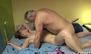 Sleder sweetheart takes a hardcore fuck from behind by an grey guy
