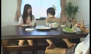 Oriental footjob under the table