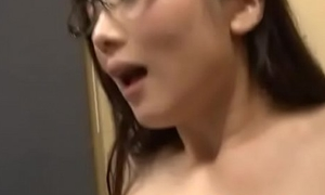 Horny Japanese AV Model in glasses seduces young cadger